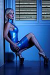 Sexy High Heels presents Monique Vegas in blue latex skirt and plateau high heels